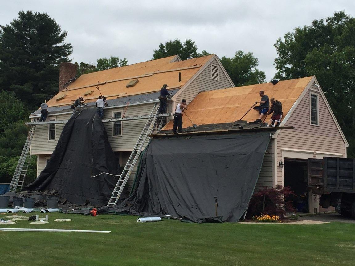 evangelous roofing company working on roof repair